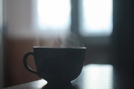 Cup of fresh, steaming hot coffee
